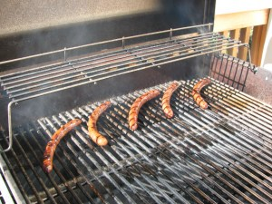 Cook sausage on a gas grill